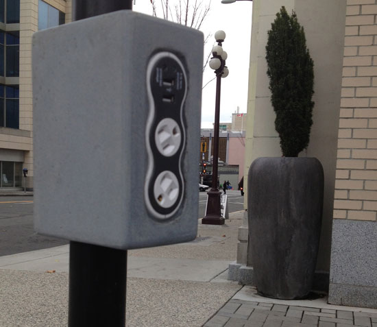 plug your phone into the usb solar charger set in concrete